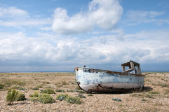 Old Boat at Dungeness, Kent, England. An abandoned boat at Dungeness, Kent, England Stock Images