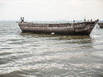 Old boat. Egret on old fishing boat in the sea Stock Photos