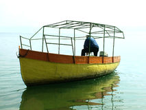 Old boat and fisherman Royalty Free Stock Photography