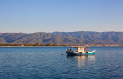 Old Boat For Fishing. One old boat on sea, view from Stavros town in Greece Stock Images