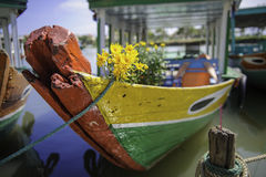 An old boat in hoi-an,vietnam. An old boat with flowers on it in hoi-an,vietnam royalty free stock photo