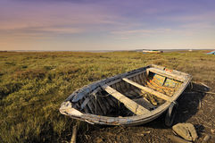 Old boat in the grass Royalty Free Stock Photo