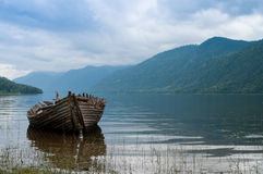 Old boat on the hazy lake Stock Photography