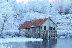 Old boat house in winter. Stock Photo