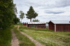 Old boat houses in Sweden. Old boat houses in Sweden in summertime stock photos