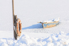 Old boat on ice. Winter landscape composition with ice, snow, re Stock Photography