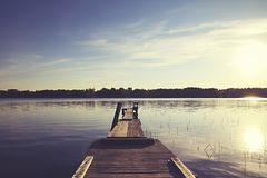 Boat pier on a lake with great sunlight royalty free stock image