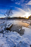 Old boat on the lake covered with snow Royalty Free Stock Photos