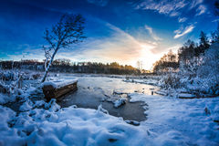 Old boat on the lake covered with snow in winter Royalty Free Stock Photography
