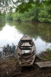 An old boat on a lake shore Royalty Free Stock Photography