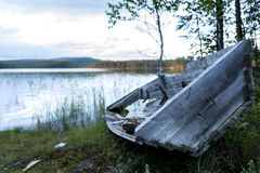 Old boat by lake Stock Photos