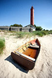 Old boat at the lighthouse Royalty Free Stock Image