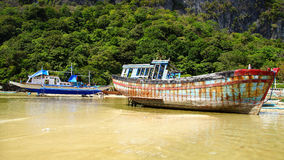 Old boat during low tide. El Nido Royalty Free Stock Image