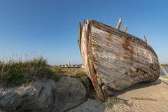 Old Boat at Low Tide in France, Normandy Stock Photography