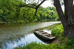 Old boat on Luznice river. Old boat on Luznice river, Czech Republic Royalty Free Stock Image