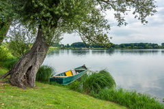 Old boat on the mantova lake Royalty Free Stock Photos