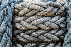 Old boat marine grey rope on the pier texture and background.  Royalty Free Stock Photos
