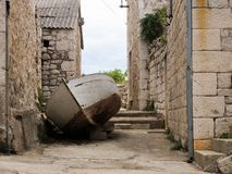 Old boat in the middle of the street of Sucuraj, Hvar island, Croatia royalty free stock photo