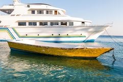 Old boat and modern yacht Stock Image