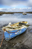Old Boat Moored in Poole Harbour. Old boat moored in Upton Lake in the back waters of Poole Harbour in Dorset Stock Photo