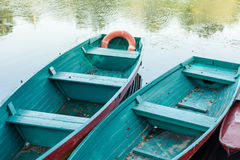 Old boat with oar near river or beautiful lake. Calm sunset on the nature. Fishing boat Stock Photography