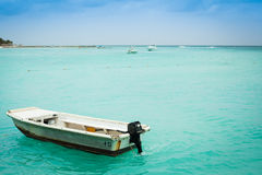 Old boat in the ocean. Small old boat in the ocean Royalty Free Stock Images