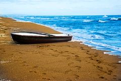 Old Boat. On the beach Stock Photography