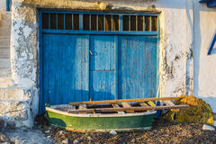 Old Boat at the picturesque fishing village of Klima on the island of Milos, Greece Royalty Free Stock Image
