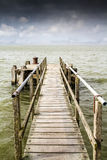 Old boat pier stretching out to sea Royalty Free Stock Photography
