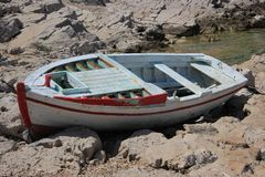 Old boat resting ashore Royalty Free Stock Images