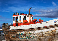 Old boat resting in dry dock Royalty Free Stock Images