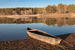 Old boat on the river bank Stock Photography