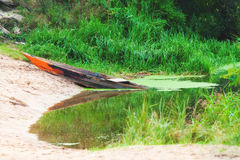 Old boat by river Stock Photo