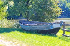 Old boat on the shore. Old boat on the river shore Stock Photo