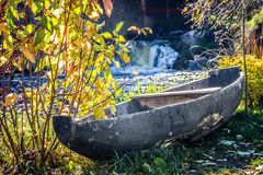 Old boat on the riverbank on a sunny autumn day Royalty Free Stock Photography
