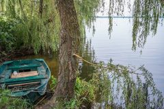 Old Boat on a riverside in Ukraine Royalty Free Stock Images