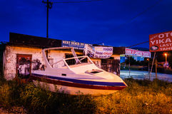 Old Boat On The Roadside At Night Royalty Free Stock Photos