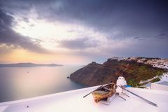 Old boat on the roof of a building in Firostefani, Santorini, Greece. Shot at sunset. Stock Images