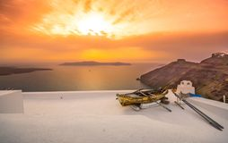 Old boat on the roof of a building in Firostefani, Santorini, Greece. Shot at sunset. Royalty Free Stock Photography