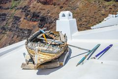 Old boat on roof of house and colorful old Royalty Free Stock Photos