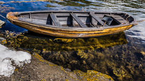 Old boat. Old rowboat painted and made ready in the sea Stock Photos