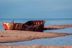 Old boat. Old rusty fishing boat on coast stock photo