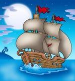 Old boat sailing sea at night Stock Photo