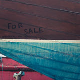Old Boat For Sale. Closeup of An Old Wooden Boat Hull Royalty Free Stock Images