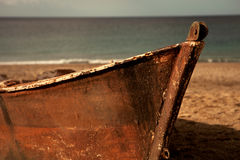 Old boat on the sand of the beach Royalty Free Stock Photo