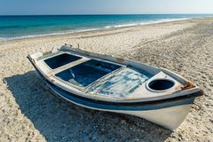 Old boat at sand beach Royalty Free Stock Photo