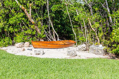 Old Boat in Sand by Lobster Trap Stock Images