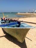 Old boat on sand near sea. Old boat on beach near blue sea Stock Image