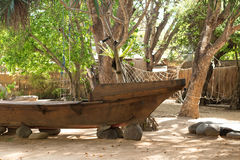 Old boat on the sand, park. Tropical Bali island, Indonesia. Royalty Free Stock Photos