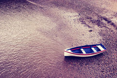 Old boat on sand with vintage filter effect Royalty Free Stock Photo